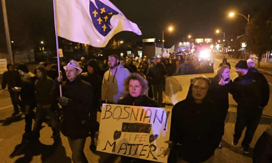 Bosnians march along Gravois Road in 2014 to protest the murder of Zemir Begic in St Louis.