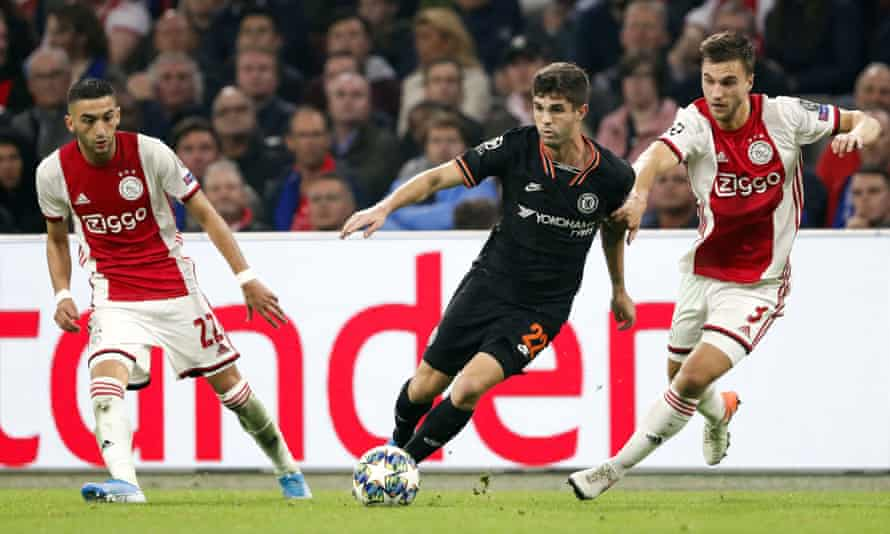 Christian Pulisic slips in between Hakim Ziyech and Joël Veltman of Ajax in his decisive substitute appearance.