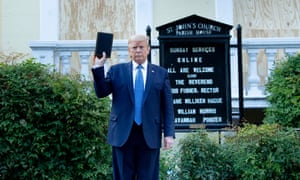 Donald Trump holds a Bible while visiting St. John's Church across from the White House after the area was cleared of protesters on Monday.