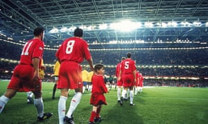 Wales and Brazil walk out on to a narrowed Millennium Stadium pitch in 2000.