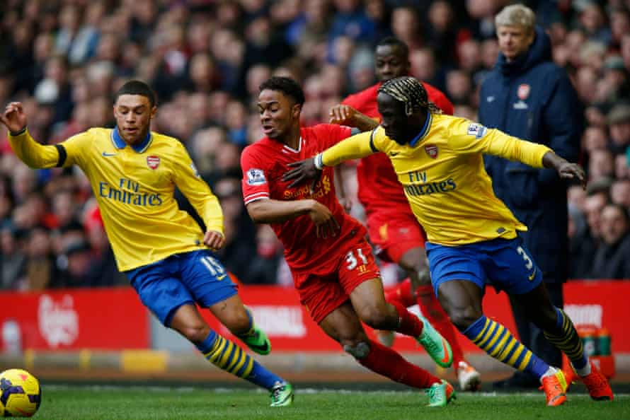 Sagna attempts to stop Liverpool's Raheem Stirling at Anfield in February 2014.