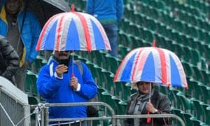 Spectators shelter under umbrellas at a Cricket World Cup match in Bristol