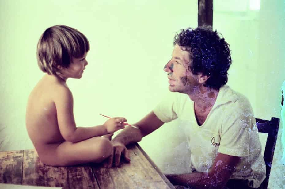 A young Adam with his father.