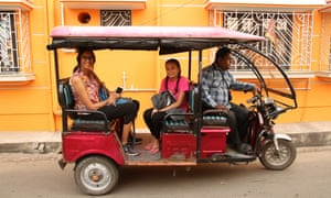 Sheela Banerjee, left, back in Chandannagar, West Bengal, and on a Toto ride with her daughter