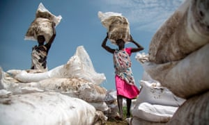 Women carry sacks of food, near Lankien, Jonglei, South Sudan, on July 3, 2017.