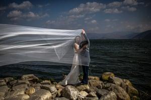 A couple pose next to Lake Erhai in Dali, Yunnan province