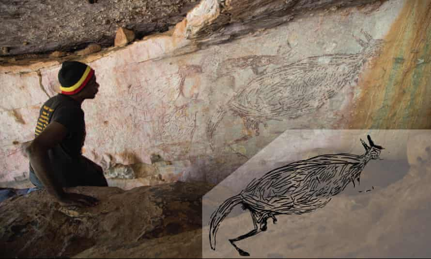 Traditional Owner Ian Waina inspecting a painting of a kangaroo that we now know is about 17,300 years old.