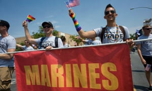 Active duty members of the US military participate in the 2017 San Diego LGBT Pride parade in San Diego, California.