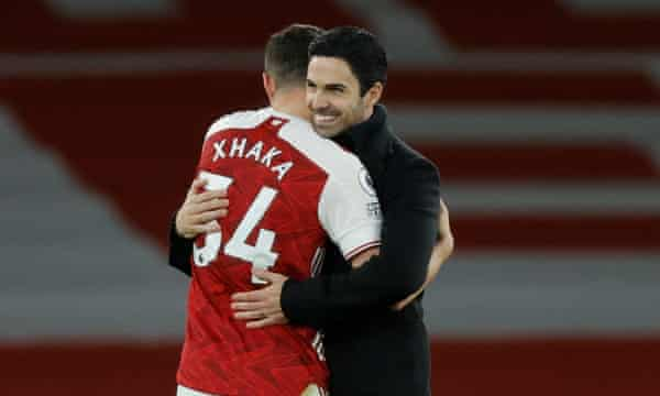 Mikel Arteta and Granit Xhaka embrace after Arsenal's win over Chelsea on Boxing Day.