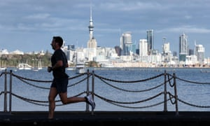 A runner exercises along Tamaki Drive on Auckland's waterfront on August 24, 2021 in Auckland, New Zealand. Level 4 lockdown restrictions are in place across New Zealand as new COVID-19 cases continue to be recorded. Under COVID-19 Alert Level 4 measures, people are instructed to stay at home in their bubble other than for essential reasons, with travel severely limited. All non-essential businesses are closed, including bars, restaurants, cinemas and playgrounds. All indoor and outdoor events are banned, while schools have switched to online learning. Essential services remain open, including supermarkets and pharmacies. (Photo by Fiona Goodall/Getty Images)