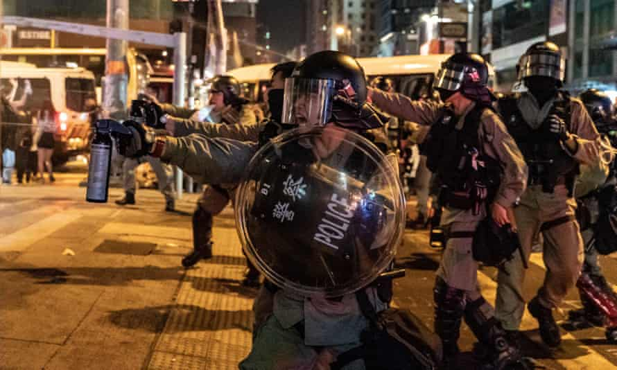 Hong Kong riot police use pepper spray in Mongkok district on Sunday
