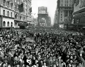 Crowds pack Times Square in New York on 7 May 1945 to celebrate the news of Germany's unconditional surrender
