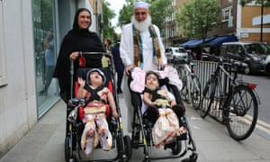 Two-year-olds Safa and Marwa Ullah leaving hospital, with their mother Zainab Bibi and their grandfather Mohammad Sadat, after successful surgery at Great Ormond Street hospital in London, to separate their heads.