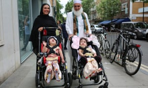 Safa and Marwa Ullah leave hospital with their mother and their grandfather.