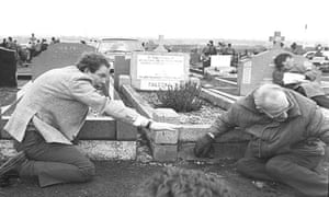 Martin McGuinness (left) warns mourners to take cover as gunshots ring out over Milltown cemetery during the funerals of three IRA terrorists in 1988.