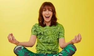 Zoe Williams sitting cross-legged wearing T-shirt and trousers with cannabis leaf