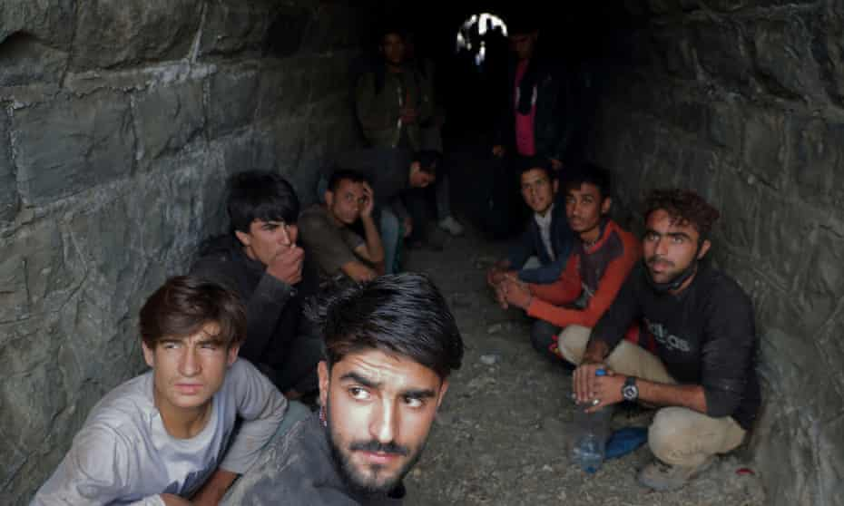 Migrants from Afghanistan hide from security forces after crossing illegally into Turkey from Iran