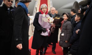 Theresa May and her husband, Philip arrive at Wuhan Tianhe International Airport in Hubei, China.