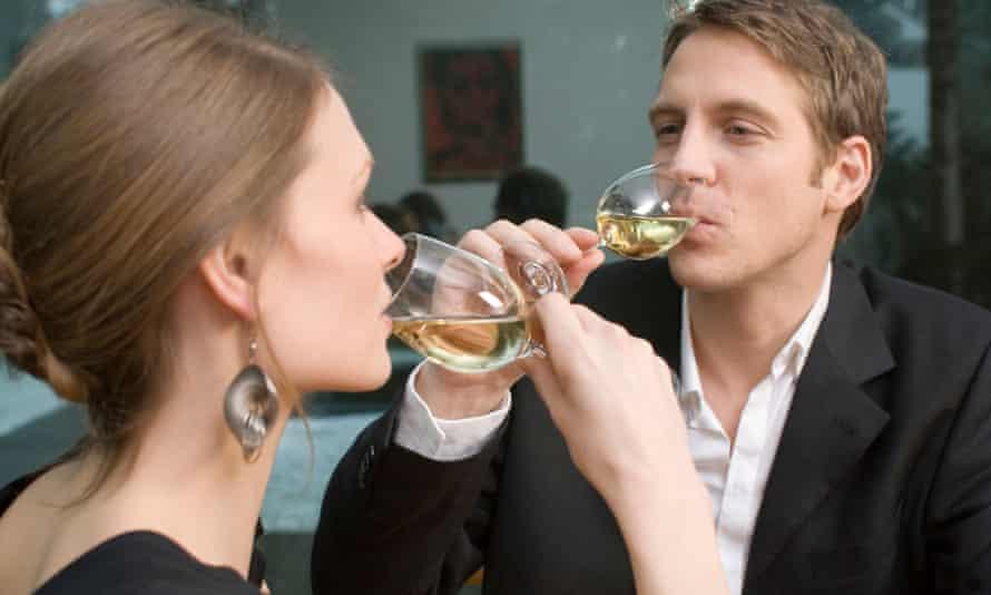 man woman drinking flirting