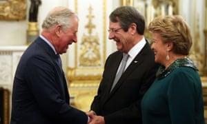 The Prince of Wales greets the President of Cyprus Nicos Anastasiades (centre) and his wife Andri during a reception at Buckingham Palace last night.