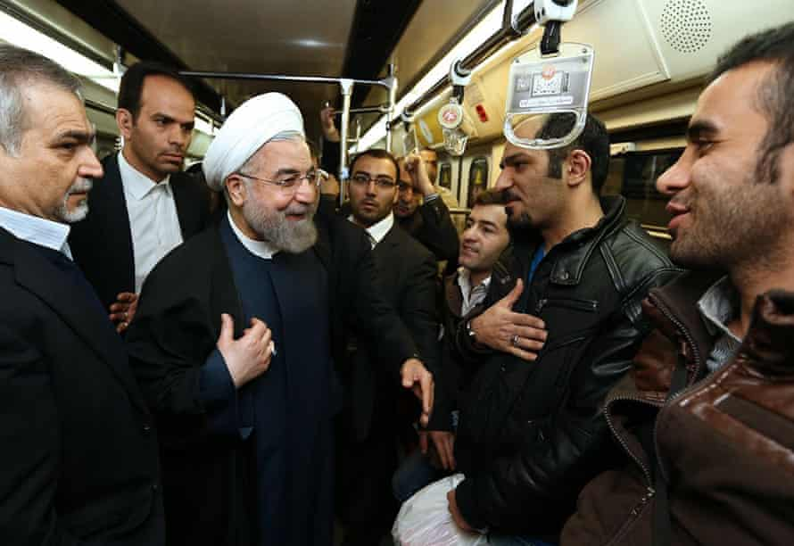 Hassan Rouhani talks with commuters in a subway in Tehran to encourage people to use public transport to control air pollution.