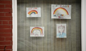 Rainbow pictures, being used as symbols of hope during the pandemic are seen in the window of a house in Manchester