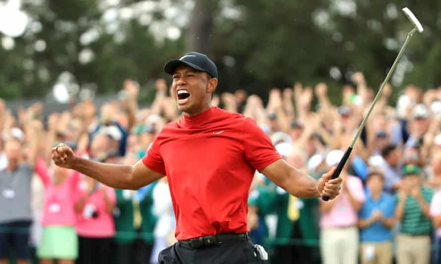 Tiger Woods winning the Masters last year.