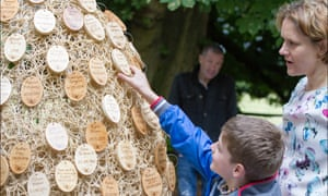 Lou Evans and her son visit the Sands baby memorial garden in Derby