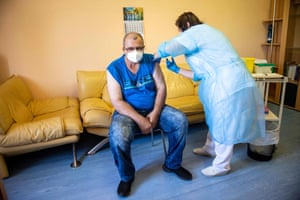 A man receives the first dose of the Sputnik V vaccine against Covid in Bratislava, Slovakia on 7 June.