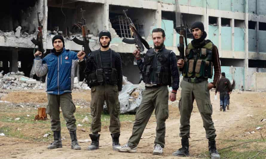 Free Syrian Army fighters pose with their weapons in eastern al-Ghouta, near Damascus.