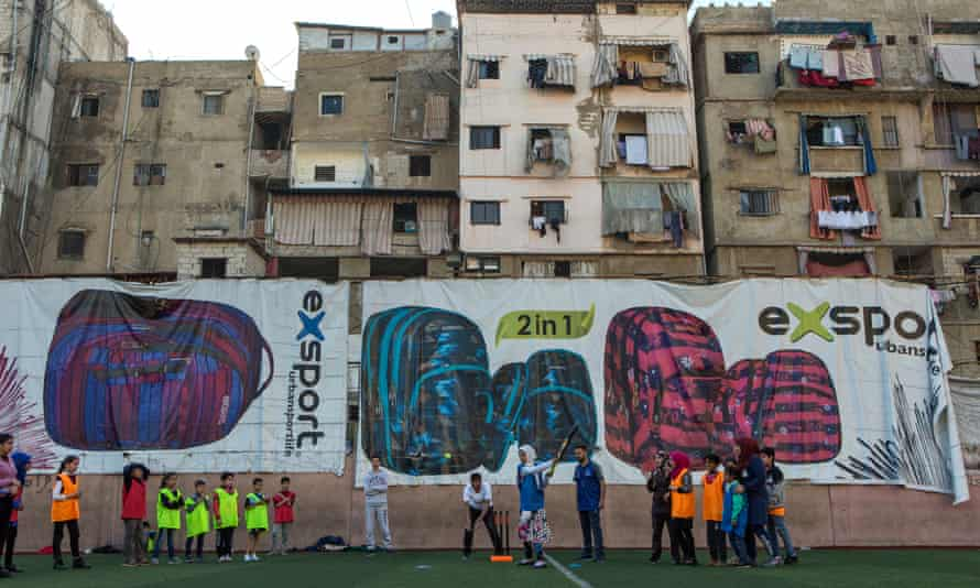 A coaching session with the apartment blocks of Shatila visible in the background.