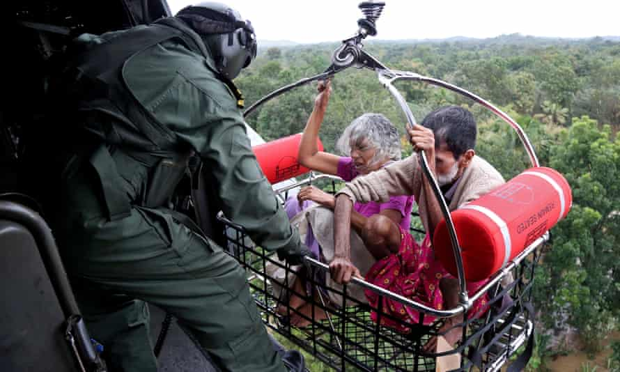 People are airlifted to safety in Kerala floods, India.