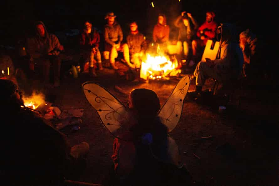 Blockaders hold a meeting around a fire after turning away an old-growth logging crew.