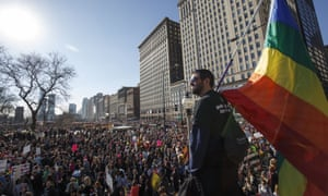 William Rosen looks over protesters as they participate in the Women's March on January 21, 2017 in Chicago, Illinois.