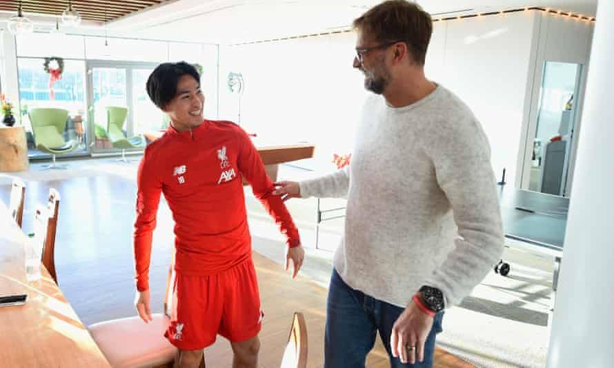 Takumi Minamino on his first day at Melwood with the Livepool manager, Jurgen Klopp.