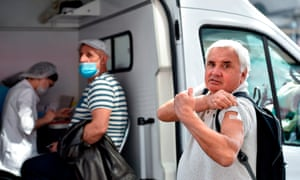 A man shows his arm after receiving a vaccination during the seasonal flu vaccination campaign in Moscow on September 7, 2020, amid the ongoing coronavirus disease pandemic. (Photo by Natalia KOLESNIKOVA / AFP) (Photo by NATALIA KOLESNIKOVA/AFP via Getty Images)