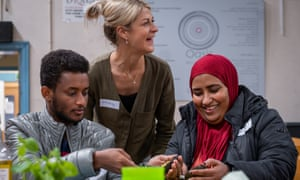 Vicky Gould, a lecturer at Cardiff Metropolitan University, helps with the cooking while chatting to recently arrived refugees.
