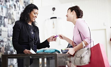 Woman paying with a card in a shop