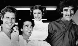 Star Wars cast members during a break in filming in 1978: from right, Peter Mayhew (Chewbacca), Carrie Fisher (the princess), Anthony Daniels (C3PO) and Harrison Ford (Han Solo).