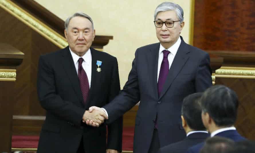 Kassym-Jomart Tokayev (R) and Nursultan Nazarbayev shake hands after the former's inauguration ceremony.