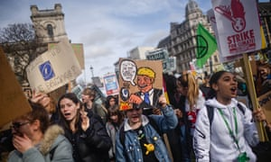 Students take part in a climate march on 14 February in London