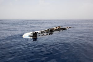 Libyan Sea, June 2016. The remnants of a rubber boat are pictured floating in the Mediterranean Sea after having been set ablaze by an unidentified source.
