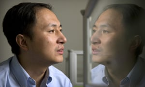 He Jiankui is reflected in a glass panel in a lab in Shenzhen, China