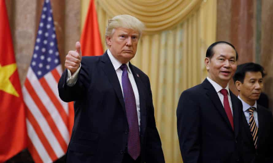 Donald Trump next to Vietnam's president, Tran Dai Quang at the Presidential Palace in Hanoi.