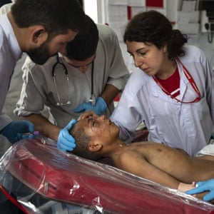 Nurse Roberta Lana examines a trauma patient at the Emergency Surgical Centre for Civilian War Victims in Kabul, Afghanistan, 22 September
