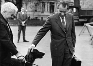 President Nixon pets his dog outside the White House, Washington DC, in197