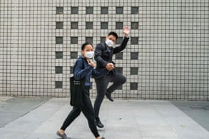 Hong Kong: Elaine and Henry Tong jump as they celebrate being found not guilty of rioting during last year's pro-democracy protests