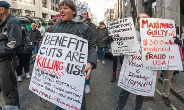 People protest at Maximus UK the US firm that have taken over the work capability assessment from Atos.