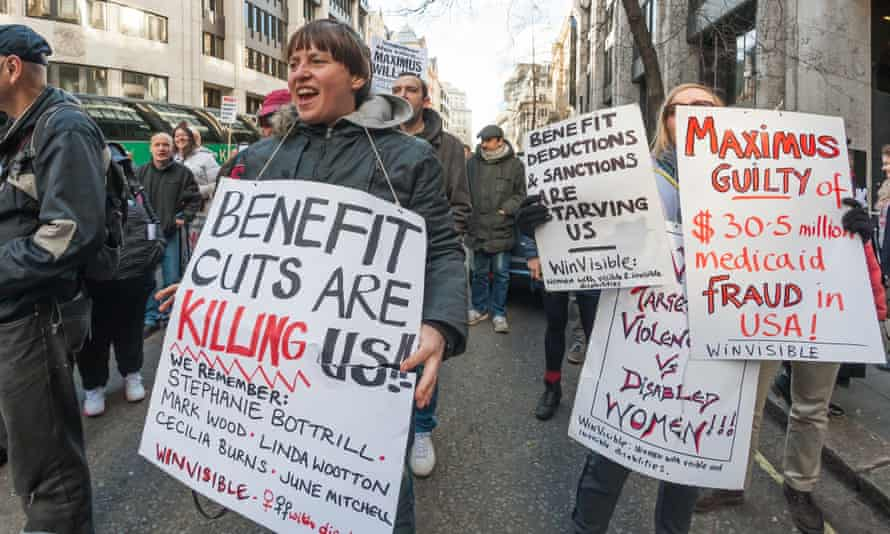 Crowds outside the Department of Work and Pensions in March, protesting against US firm Maximus taking over the fitness-to-work tests from Atos.