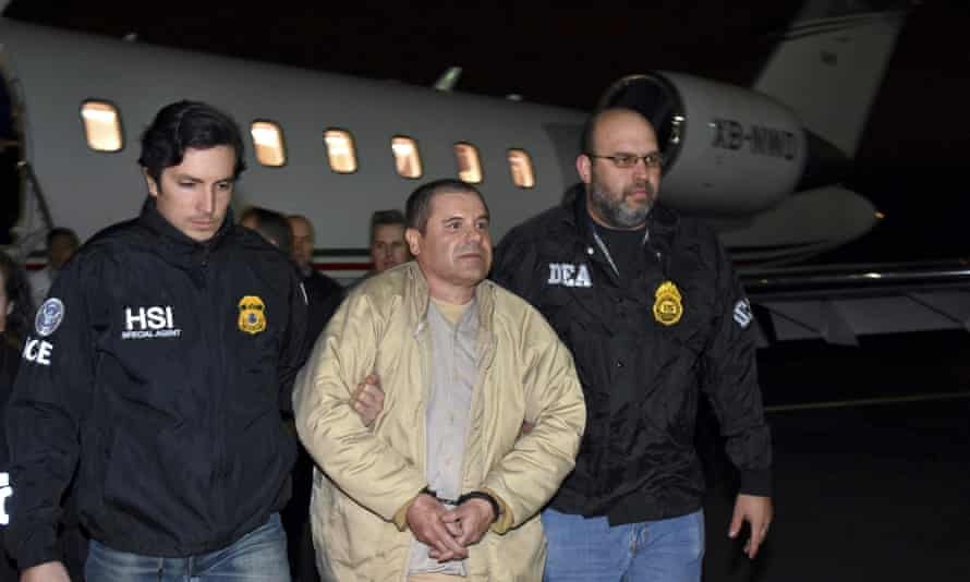 Authorities escort El Chapo from a plane to a waiting SUV at Long Island MacArthur Airport in Ronkonkoma, New York on 19 January 2017.